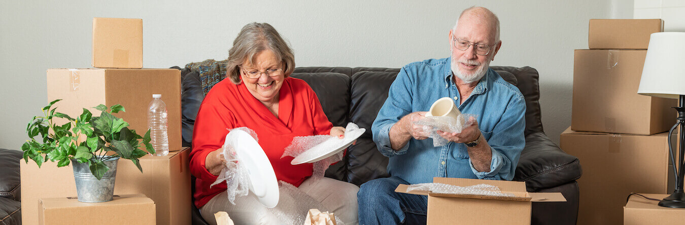 Senior Adult Couple Packing