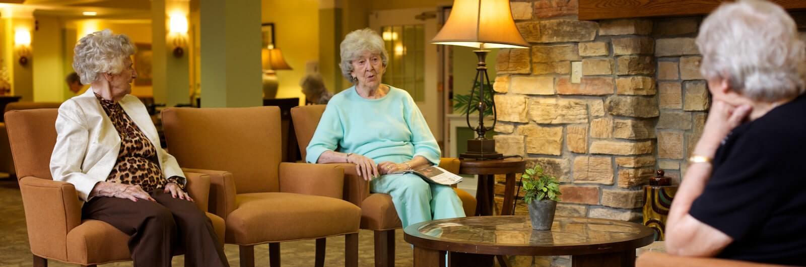Elderly residents sitting in lounge