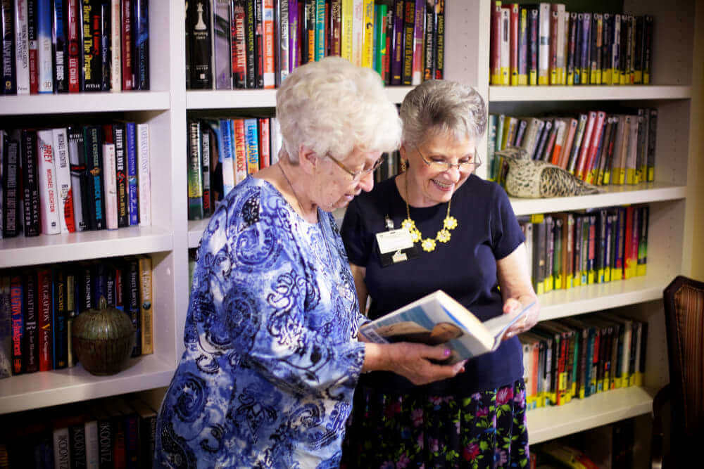 senior residents reading in the study