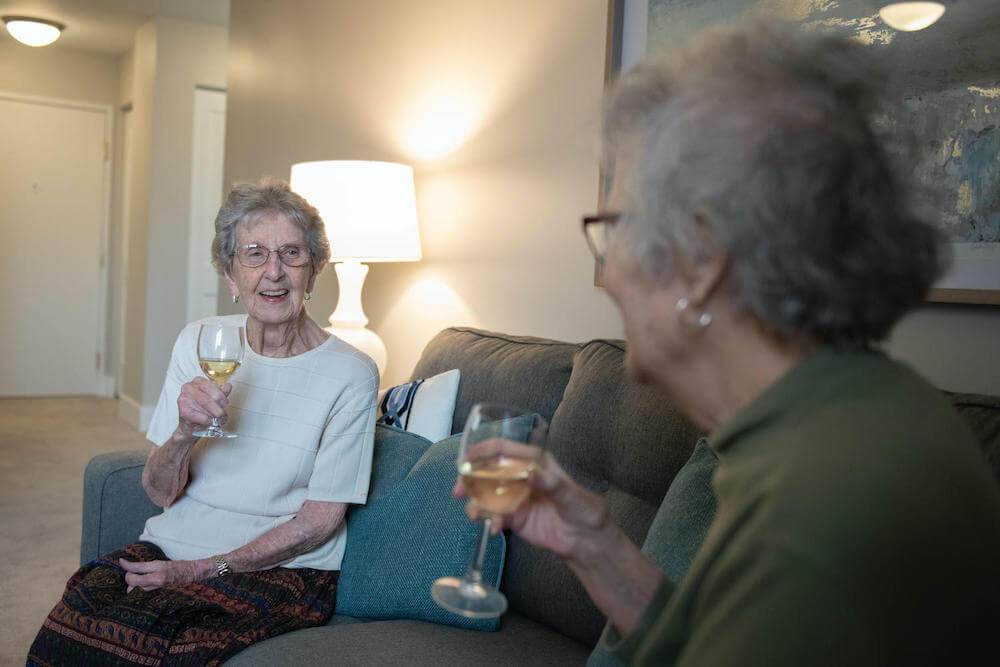 residents drinking wine