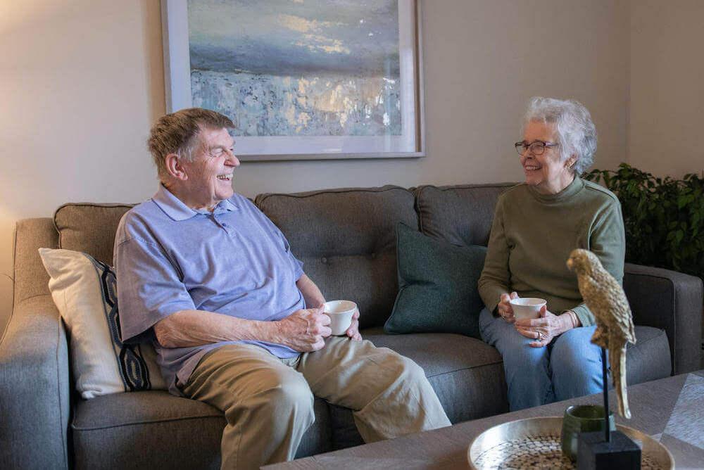 Elderly couple having coffee