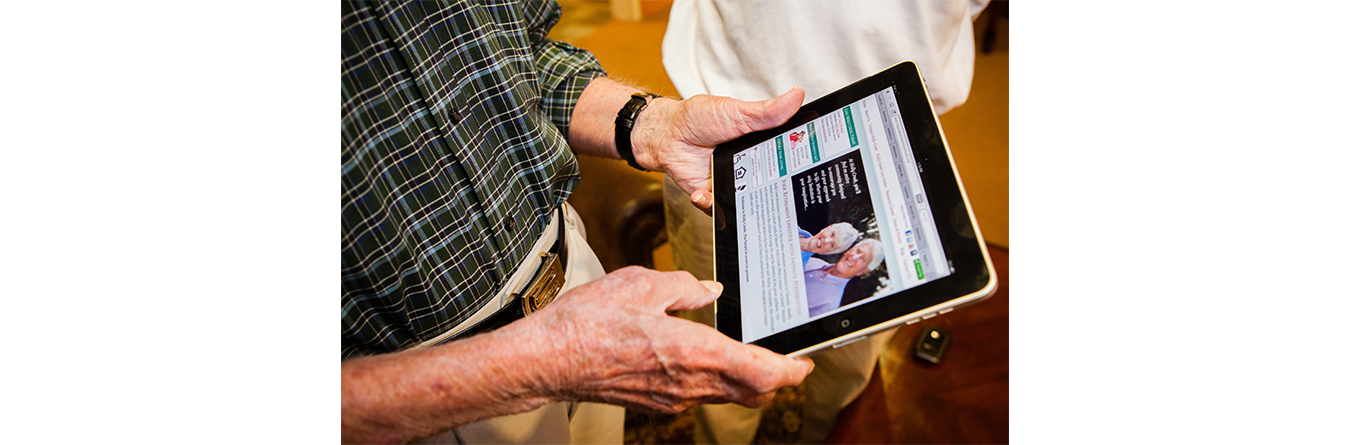 elderly man using a tablet