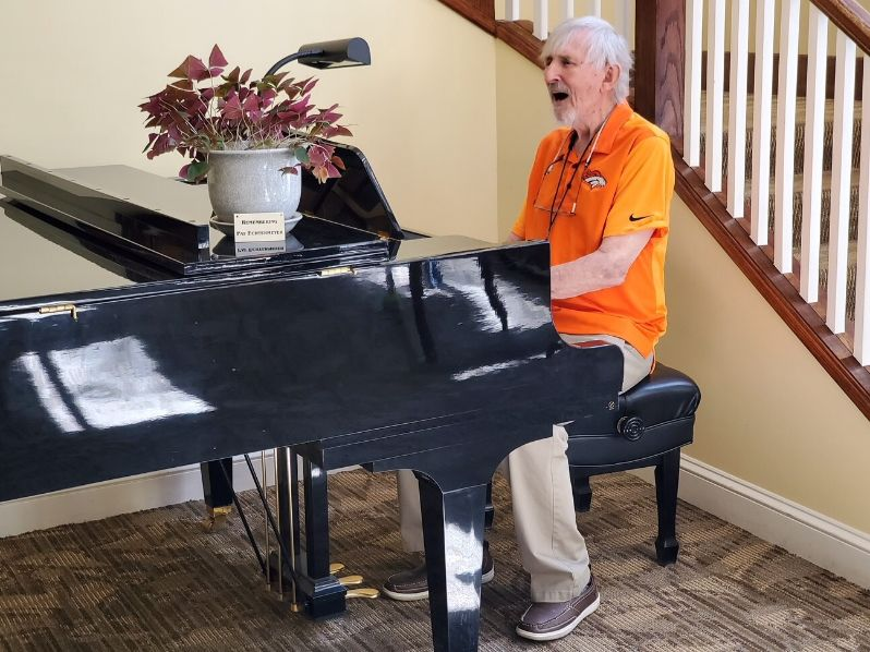 Elderly man playing the piano