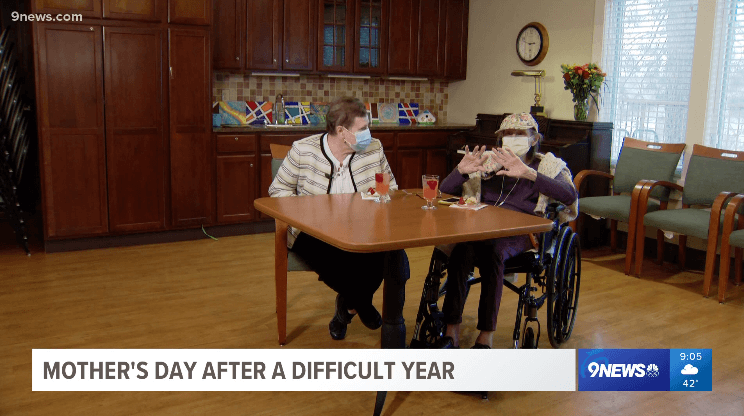 Two Someren Glen residents being interviewed while sitting at a table.